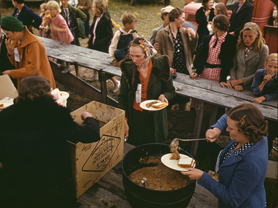 1940 photo of a group serving pinto beans